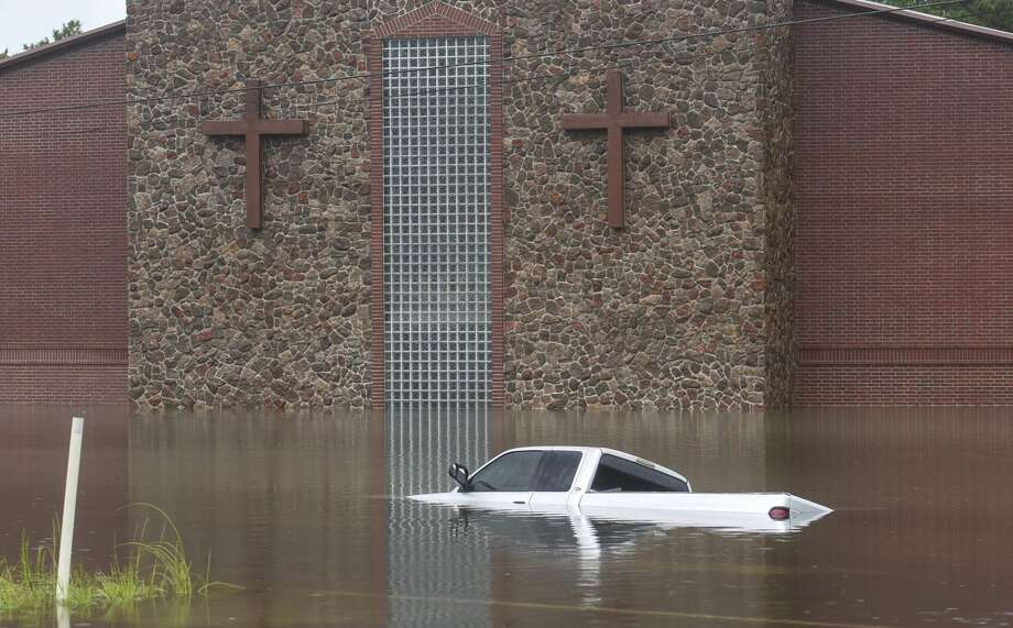 A truck sits largely submerged in front of a church near Vidor, Texas Thursday afternoon. Photo taken on Thursday, 09/19/19. Ryan Welch/The Enterprise Photo: Ryan Welch/The Enterprise