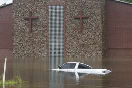 A truck sits largely submerged in front of a church near Vidor, Texas Thursday afternoon. Photo taken on Thursday, 09/19/19. Ryan Welch/The Enterprise