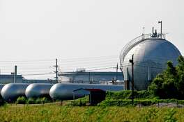 Natural gas sits in storage tanks