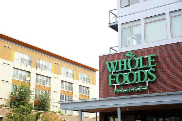 The final touches are put on the new Alaska Junction Whole Foods before it opens Oct. 9.