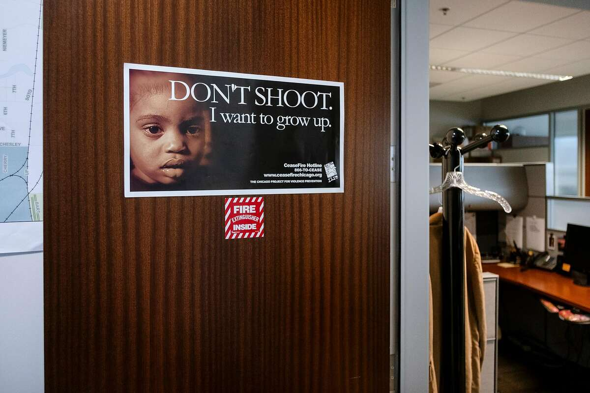 A poster is seen on a door in the City of Richmond's Office of Neighborhood Safety, which runs the city's Operation Peacemaker Fellowship, at City Hall in Richmond, Calif., on Thursday, September 19, 2019.