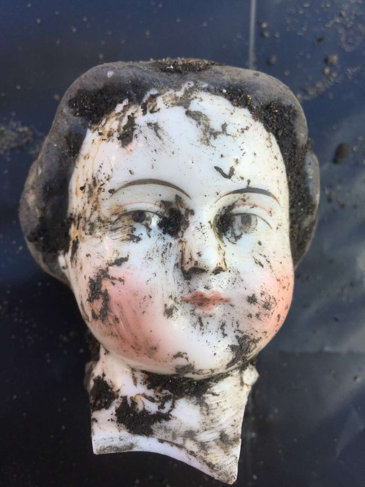 A doll head was one of thousands of artifacts discovered under layers of soil during an affordable housing construction project at the Embarcadero waterfront.