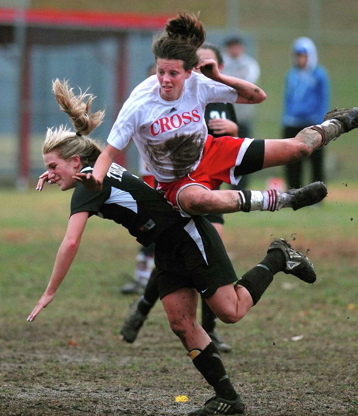 In this file photo Natalie Beach, then a player for Wilbur Cross High School, top, gets upended by Trumbull's Jess Deigel as Beach got a header during the first half.