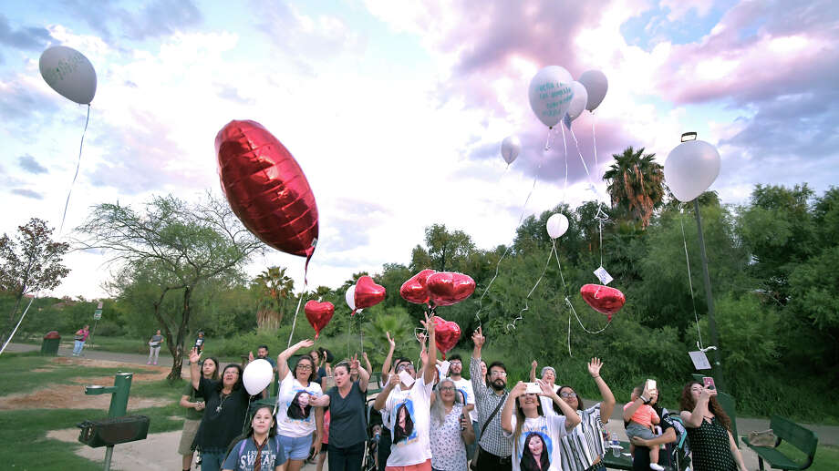 Family and friends of Claudine Luera gathered at North Central Park on Saturday for a remembrance vigil to mark the first anniversary of her death. White and heart-shaped red balloons with messages attached were released in her honor. Photo: Cuate Santos/Laredo Morning Times