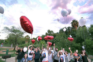 Family and friends of Claudine Luera gathered at North Central Park on Saturday for a remembrance vigil to mark the first anniversary of her death. White and heart-shaped red balloons with messages attached were released in her honor.