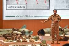 """TOPSHOT - Saudi defence ministry spokesman Colonel Turki bin Saleh al-Malki displays pieces of what he said were Iranian cruise missiles and drones recovered from the attack site that targeted Saudi Aramco's facilities, during a press conference in Riyadh on September 18, 2019. - Saudi Arabia said that strikes on its oil infrastructure came from the """"north"""" and were sponsored by Iran, but that the kingdom was still investigating the exact launch site. (Photo by Fayez Nureldine / AFP)FAYEZ NURELDINE/AFP/Getty Images"""