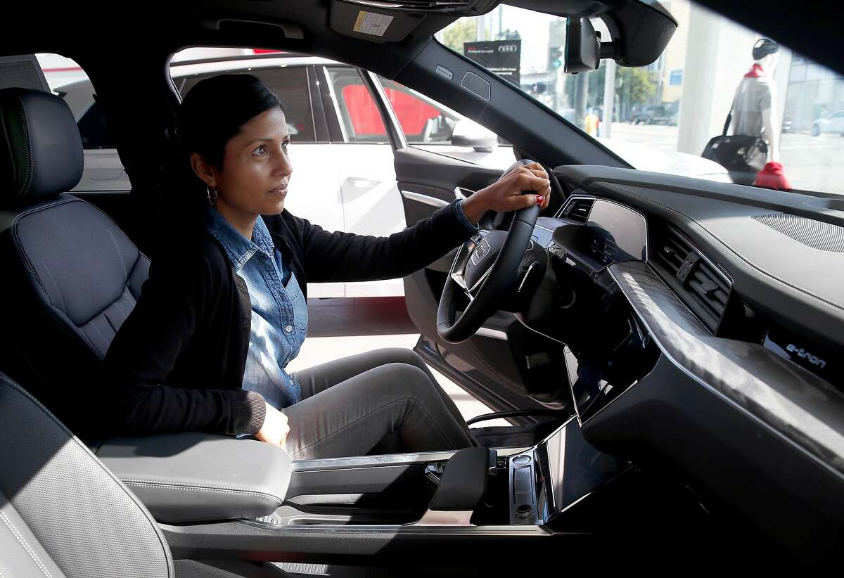 Shantal De Silva sits behind the wheel of an Audi e-tron electric SUV at the Audi dealership in San Francisco, Calif. on Saturday, July 6, 2019. Assemblyman Phil Ting, D-San Francisco, is proposing legislation that would increase the typical rebate for an electric car to as high as $7,500.
