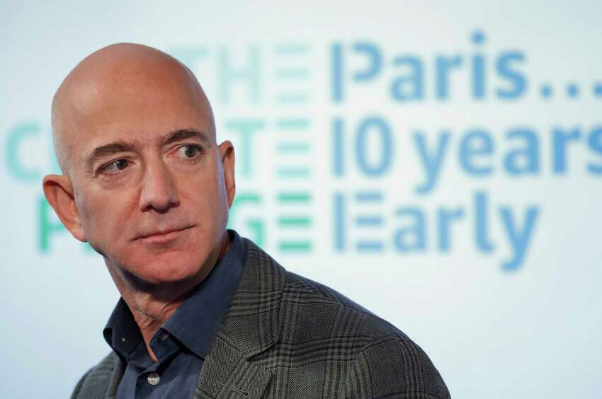 Amazon CEO Jeff Bezos speaks during his news conference at the National Press Club in Washington, Thursday, Sept. 19, 2019. Bezos announced the Climate Pledge, setting a goal to meet the Paris Agreement 10 years early. (AP Photo/Pablo Martinez Monsivais)