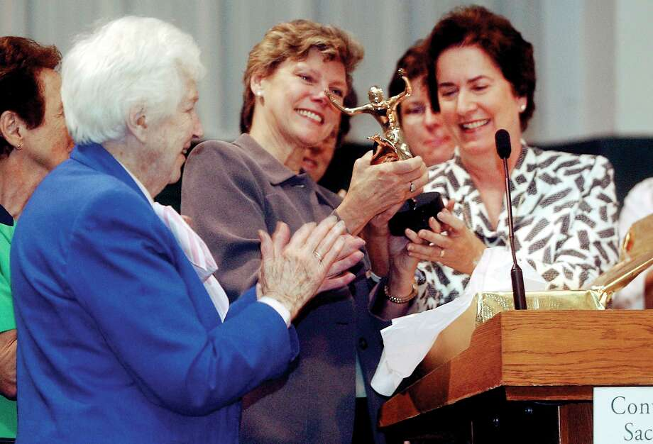 Cokie Roberts receives the Woman of Spirit Award in Greenwich in 2004. At right is Sister Joan Magnetti then the school's headmistress. Photo: Hearst Connecticut Media