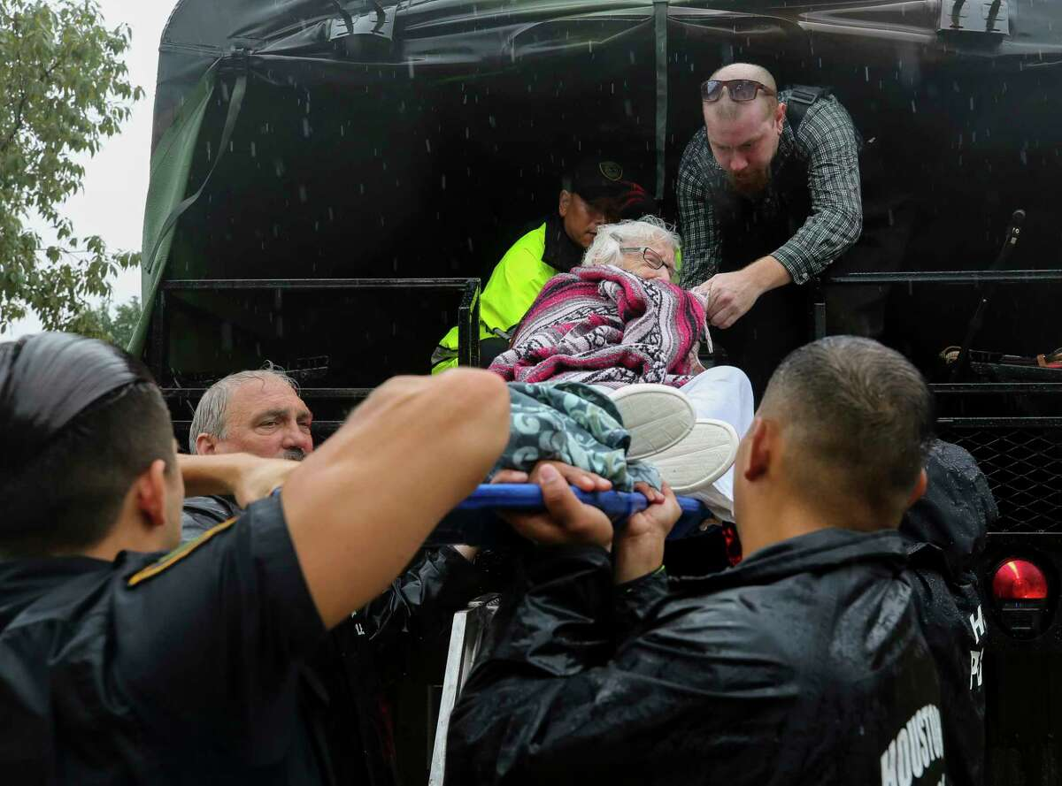 Doris Dupree, 93, is unloaded from a Houston Police high-water rescue vehicle after she was rescued from her home Thursday, Sept. 19, 2019, in Kingwood, Texas. Tropical Storm Imelda brought heavy rain, causing flooding in the greater Houston area.
