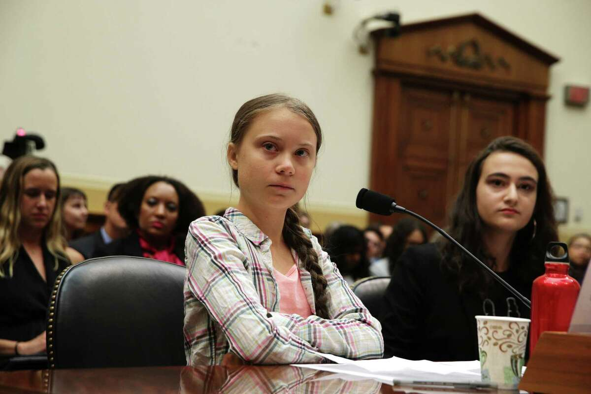 WASHINGTON, DC - SEPTEMBER 18: Founder of Fridays For Future Greta Thunberg (L) and co-founder of This Is Zero Hour and plaintiff in Piper v. State of Washington Jamie Margolin (R) testify during a House Foreign Affairs Committee Europe, Eurasia, Energy and the Environment Subcommittee and House (Select) Climate Crisis Committee joint hearing September 18, 2019 on Capitol Hill in Washington, DC. Thunberg, who recently sailed across the Atlantic Ocean in a zero-carbon emissions sailboat, is in Washington to discuss the climate crisis with lawmakers and will speak at the UN Climate Action Summit on September 23 in New York. (Photo by Alex Wong/Getty Images) *** BESTPIX ***
