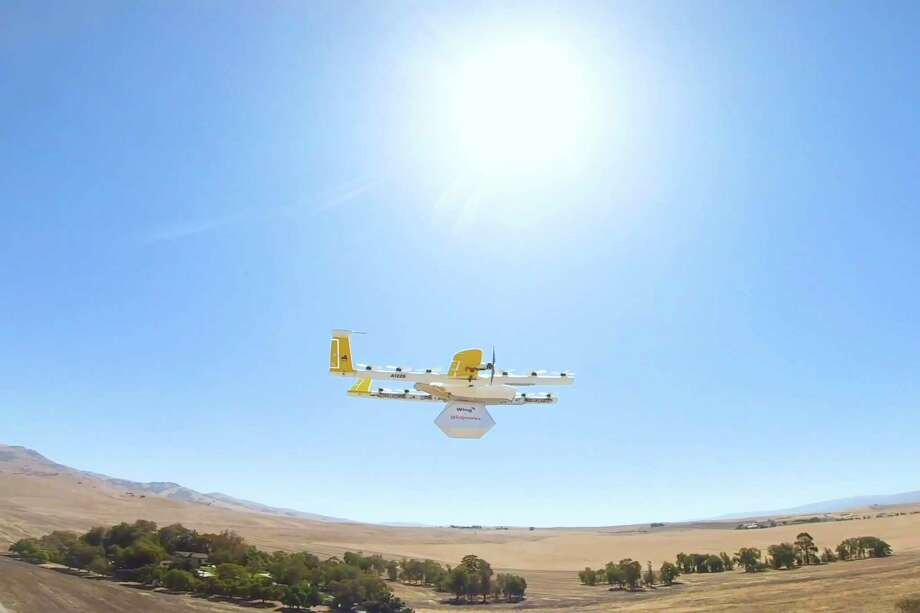 This undated image made from video provided in September 2019 by Wing, a member of the Alphabet family of companies, shows a delivery drone test which is part of a partnership with Walgreens. On Thursday, Sept. 19, 2019, Walgreens and the Google affiliate said they are testing drone deliveries that can put drugstore products on customer doorsteps minutes after being ordered. (Wing via AP) / Wing Aviation LLC