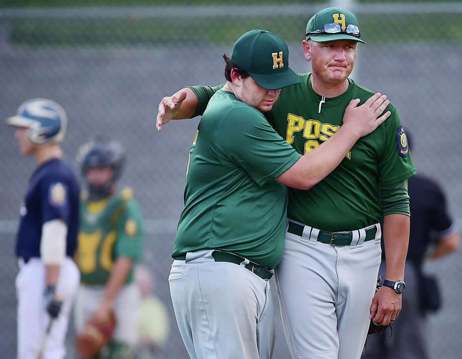 Hamden manager Ray Guarino replaces first baseman Frank Niro, Tuesday, July 24, 2018, in the American Legion senior state tournament at Hamden High School. Trumbull won, 13-0. Photo: Catherine Avalone / Hearst Connecticut Media / New Haven Register