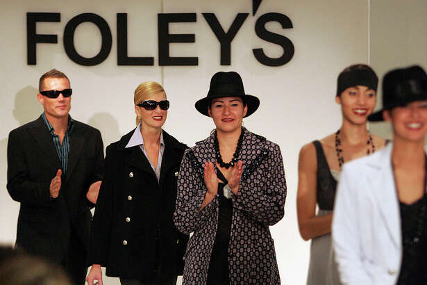 Models applaude the audience at the conclusion of a fashion show at Foley's at the Shops at La Cantera on Tuesday, Sept. 13, 2005. (Kin Man Hui/staff)