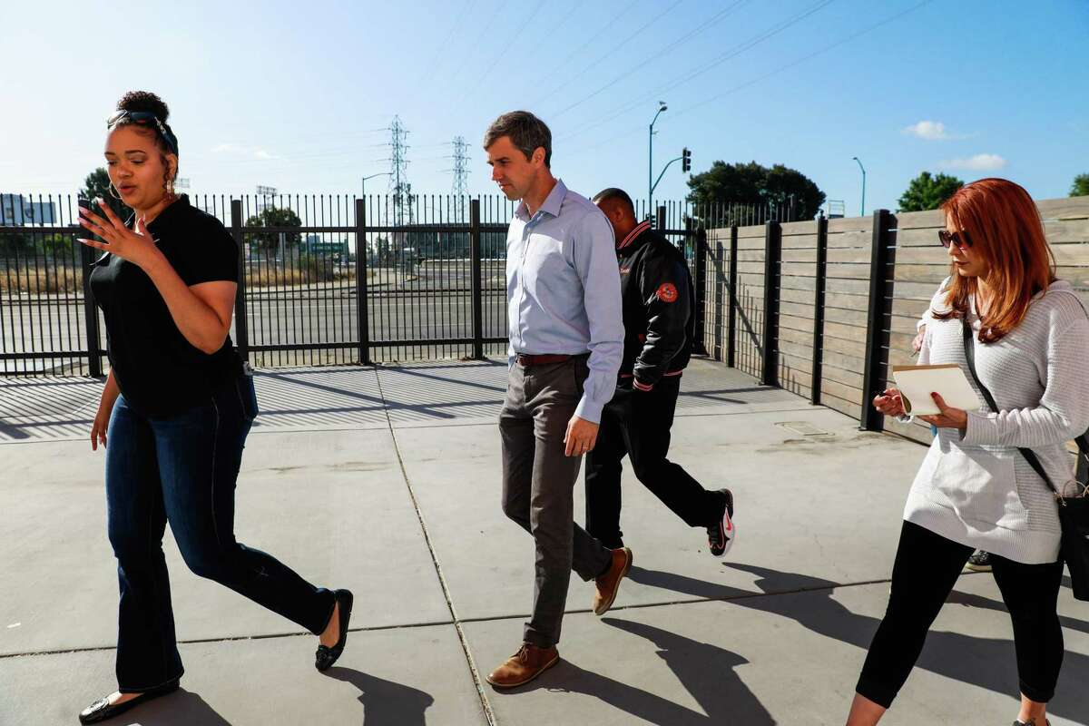 Presidential candidate Beto O'Rourke (center) walks into cannabis dispensary Blunts and Moore in Oakland, California, on Thursday, Sept. 19, 2019.