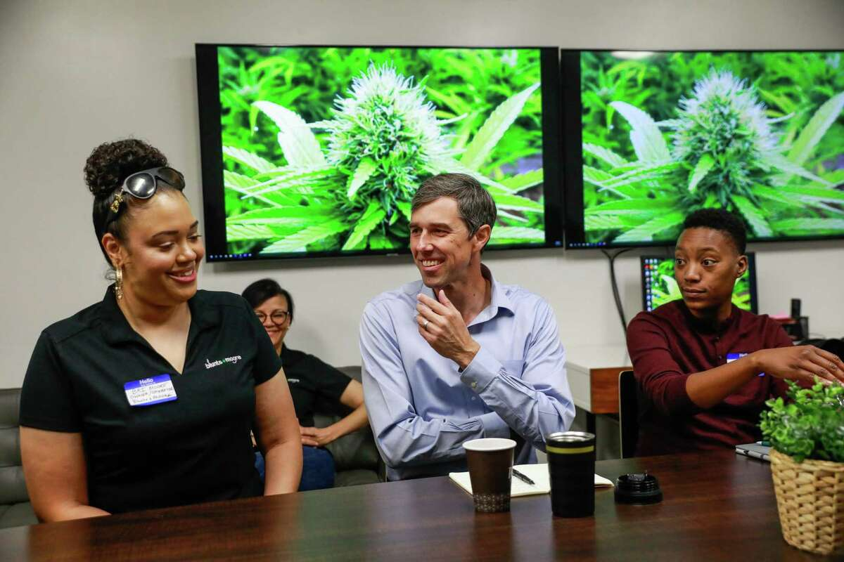 Presidential candidate Beto O'Rourke (center) laughs during a roundtable discussion about the cannabis industry at Blunts and Moore in Oakland.