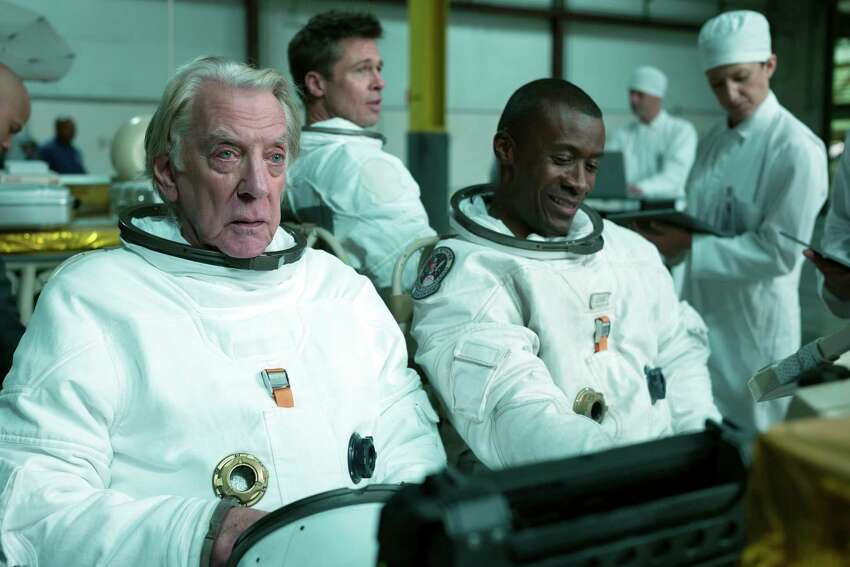 This image released by 20th Century Fox shows, from left, Donald Sutherland, Brad Pitt and Sean Blakemore in a scene from