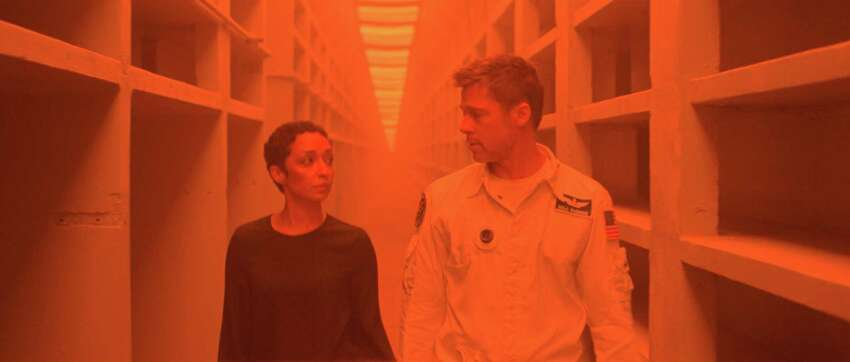 This image released by 20th Century Fox shows Ruth Negga, left, and Brad Pitt in a scene from