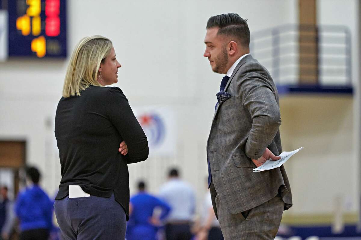 Former Shenendehowa basketball standout Matt Miner, right, talks with St. Edward's women's basketball coach J.J. Fiehl. Miner was an assistant at St. Edward's before joining the Siena men's basketball coaching staff as special assistant to coach Carmen Maciariello. (Courtesy of St. Edward's)