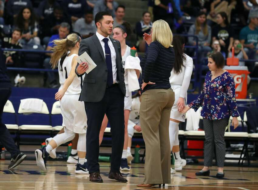 Former Shenendehowa basketball standout Matt Miner, left, talks with St. Edward's women's basketball coach J.J. Fiehl. Miner was an assistant at St. Edward's before joining the Siena men's basketball coaching staff as special assistant to coach Carmen Maciariello. (Courtesy of St. Edward's)