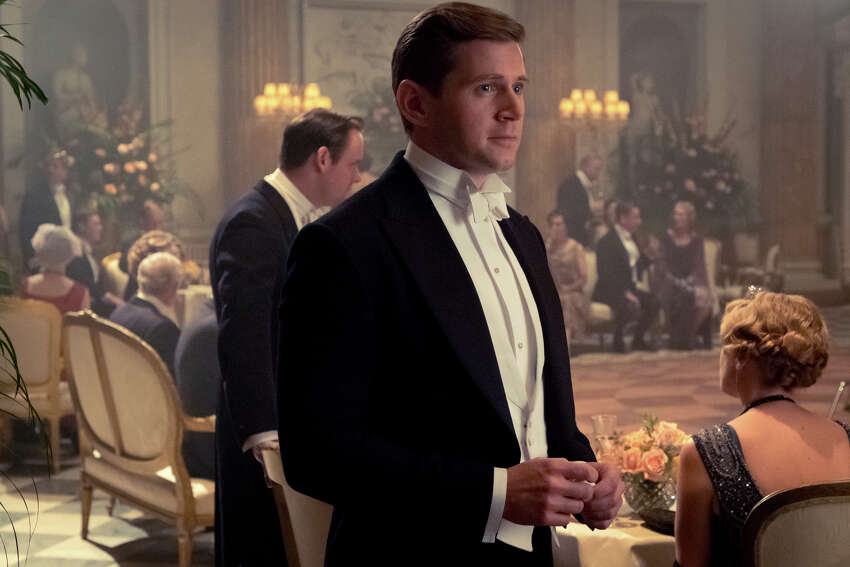 This image released by Focus Features shows Allen Leech stars as Tom Branson in