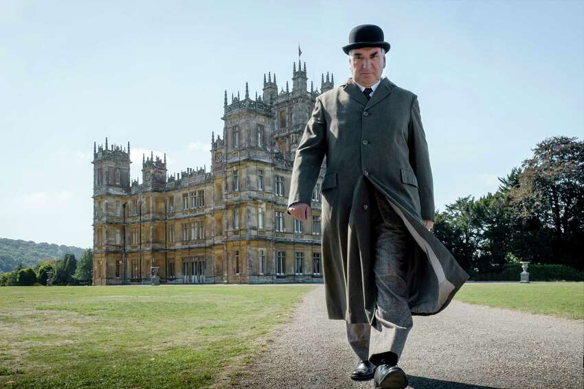 This image released by Focus features shows Jim Carter as Mr. Carson in a scene from