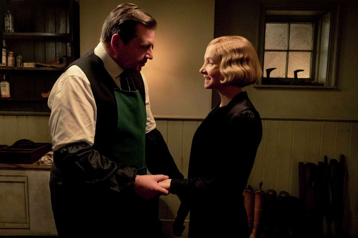 This image released by Focus Features shows Brendan Coyle as John Bates, left, and Joanne Froggatt as Anna Bates stars as Andy in