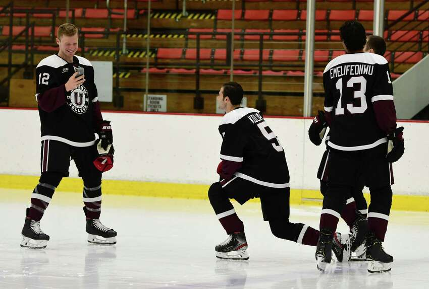 Union hockey player Fletcher Fineman, left, smiles after taking a photo of a few of his teammates during media day at Union College on Thursday, Sept. 19, 2019 in Schenectady, N.Y. (Lori Van Buren/Times Union)
