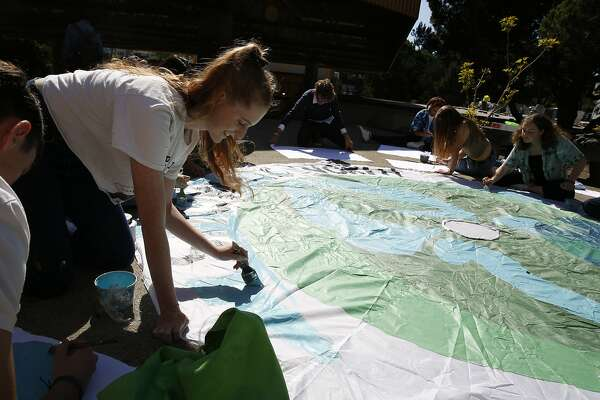 Grace McGee (left), co-president Asawa SOTA Environmental Club makes a sign for the Climate Strike with other club members and students at Ruth Asawa School of the Arts on Thursday, September 19, 2019 in San Francisco, CA.