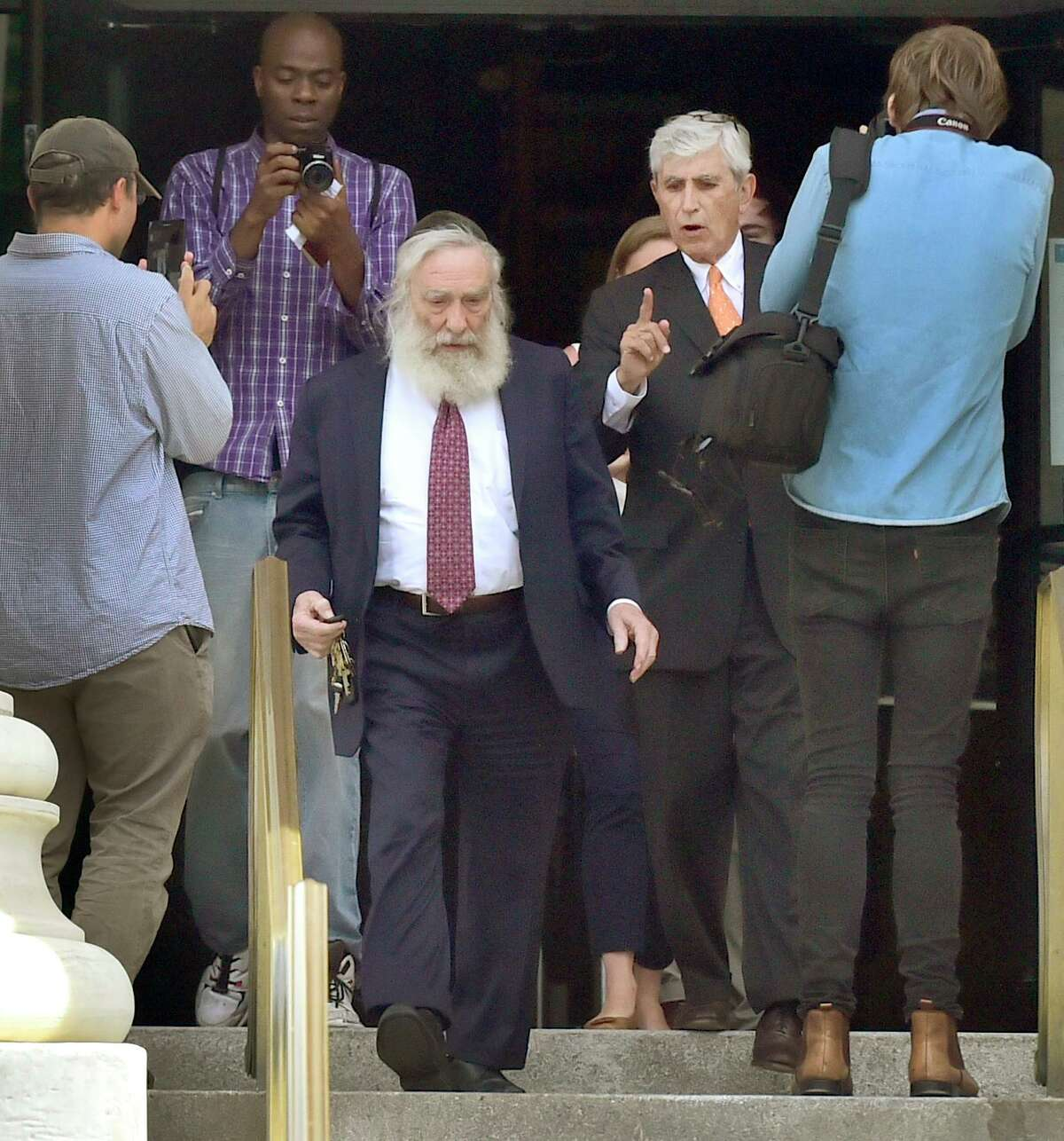 Rabbi Daniel Greer, 77, of New Haven, third from left, leaves New Haven Superior Court with his attorney William Dow III, of New Haven, after he was arraigned on sexual assault charges in 2017.