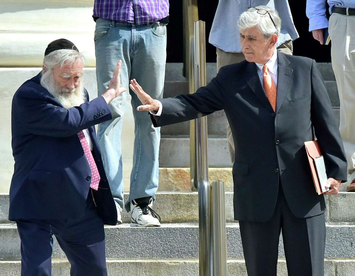 Rabbi Daniel Greer, 77, of New Haven, left, says goodbye to his attorney, William Dow III of New Haven, on the steps of Superior Court in New Haven in 2017.