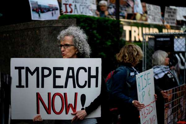 A demonstrator takes part in a protest outside of Trump International Tower this summer. A reader considers certain Democrats far more impeachable.