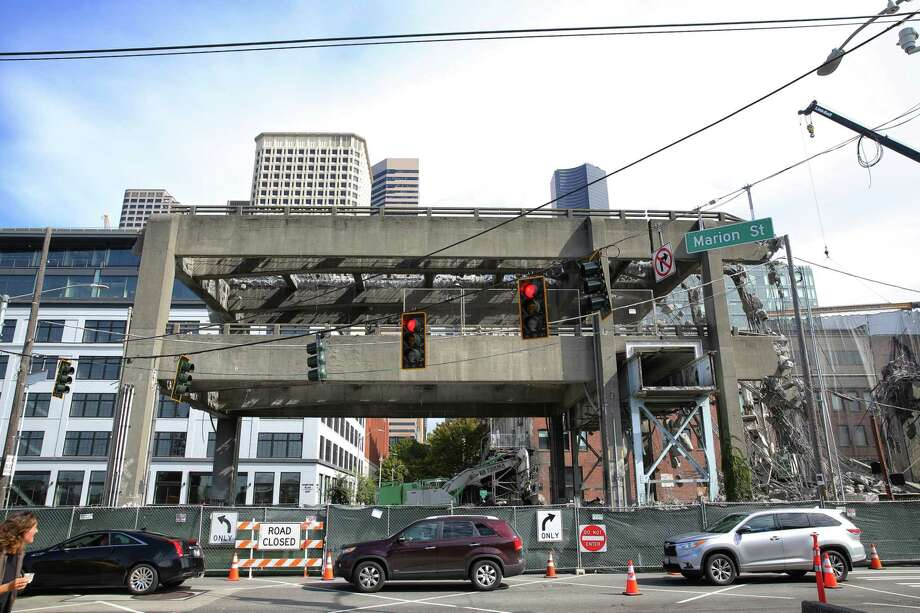 Demoliton crews continue work on the last remaining section of the Alaskan Way Viaduct near Marion Street, which come down over the weekend, Thursday, Sept. 19, 2019. Photo: Genna Martin, Seattlepi.com / GENNA MARTIN
