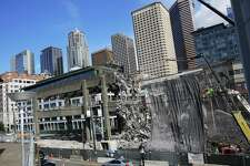 Demoliton crews continue work on the last remaining section of the Alaskan Way Viaduct near Marion Street, which come down over the weekend, Thursday, Sept. 19, 2019.