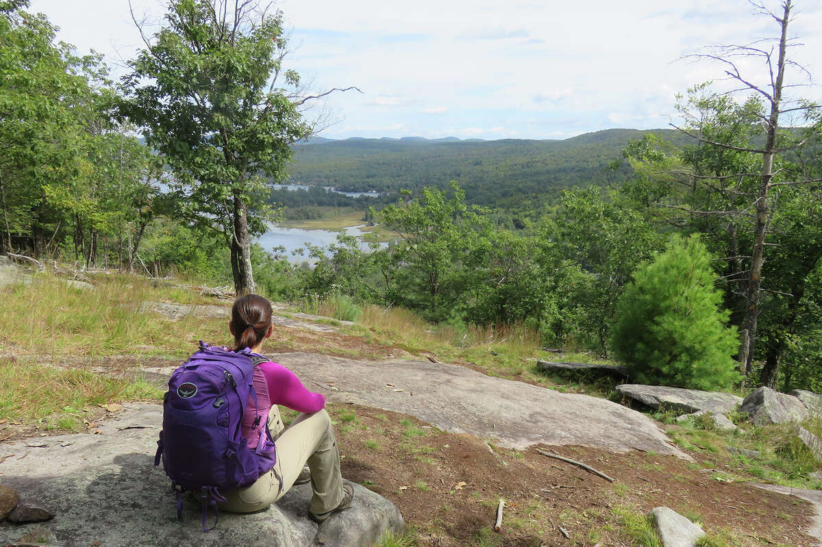 Gillian Scott enjoys the view of Brant Lake from Bartonville Mountain. (Herb Terns / Times Union)
