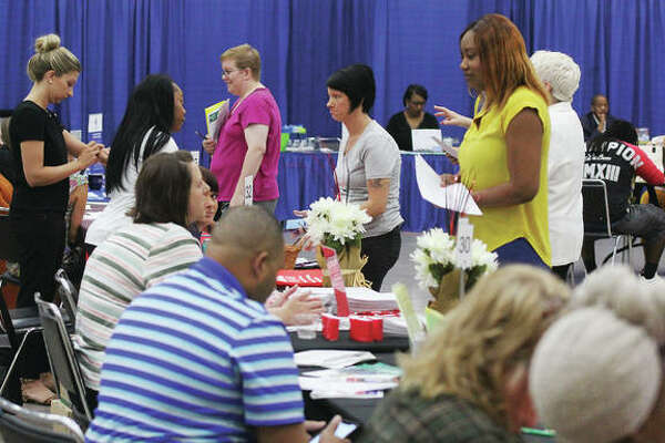 Job seekers talk to potential employers at Jobs Plus '19, the annual job fair sponsored by Madison County Employment and Training and the St. Clair County Intergovernmental Grants Department. The fair, held Thursday morning at Gateway Convention Center in Collinsville, featured almost 90 employers, schools and agencies and attracted a steady stream of job-seekers.