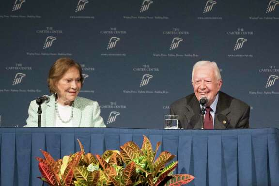 Former President Jimmy Carter and Rosalynn Carter talk about the future of The Carter Center and their global work during a town hall, Tuesday, Sept. 17, 2019, in Atlanta. Carter said he doesn't believe he could have managed the most powerful office in the world as an 80 year old. Carter didn't tie his answer to any of his fellow Democrats running for president. But two leading 2020 candidates, Joe Biden and Bernie Sanders, would turn 80 during their terms if elected. Biden is 76. Sanders is 78. (Branden Camp/Atlanta Journal-Constitution via AP)