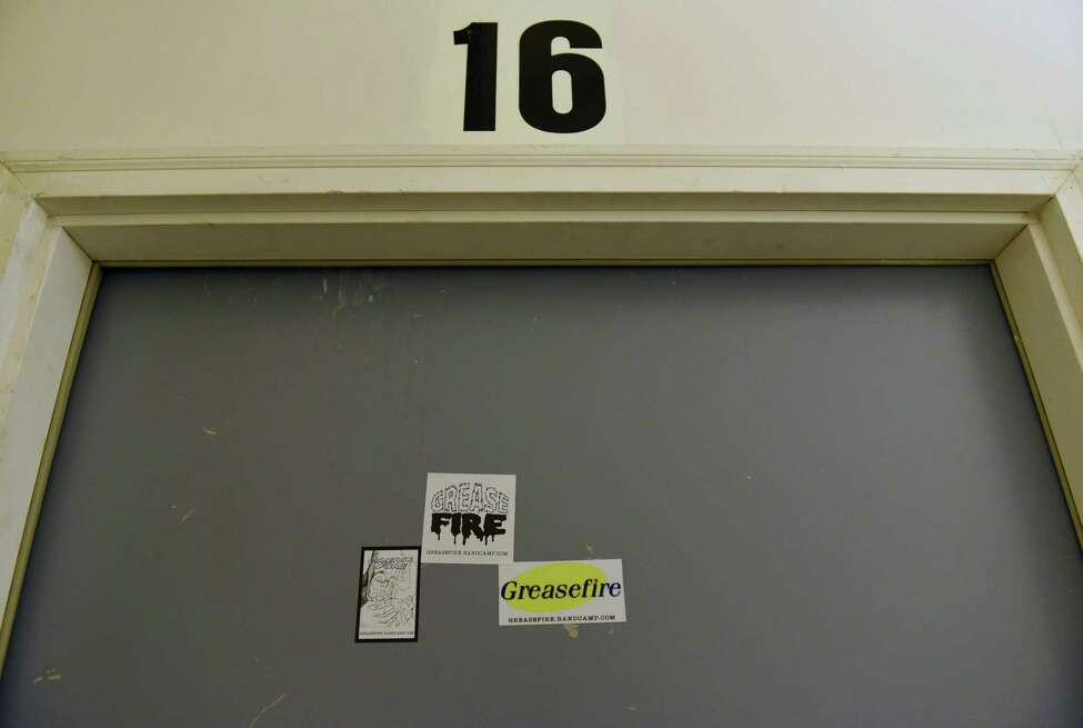 Stickers are seen on the studio door where local band Greasefire rehearses at North Albany Studios on Tuesday, Sept. 10, 2019 in Albany, N.Y. (Lori Van Buren/Times Union)