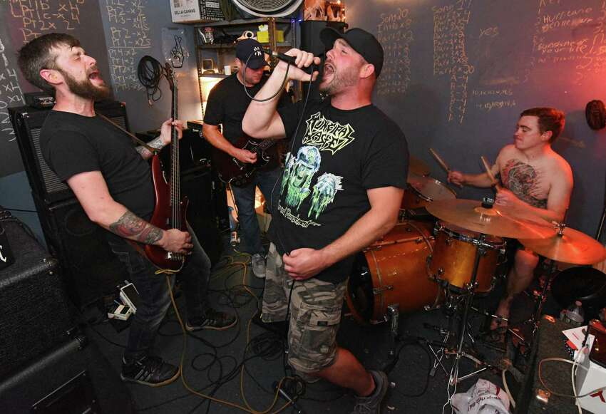Local band Greasefire, from left, Mike Kuehn, Nate Glass, Kelly Martin and Ryan Kenney, rehearse a song at North Albany Studios on Tuesday, Sept. 10, 2019 in Albany, N.Y. (Lori Van Buren/Times Union)