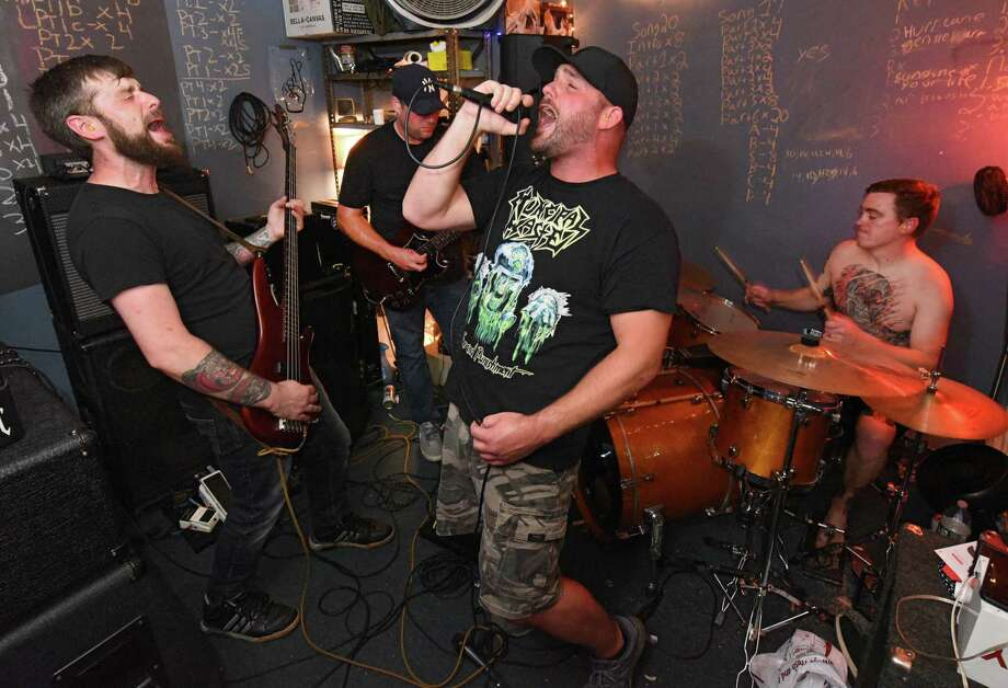 Local band Greasefire, from left, Mike Kuehn, Nate Glass, Kelly Martin and Ryan Kenney, rehearse a song at North Albany Studios on Tuesday, Sept. 10, 2019 in Albany, N.Y. (Lori Van Buren/Times Union) Photo: Lori Van Buren / 20047792A
