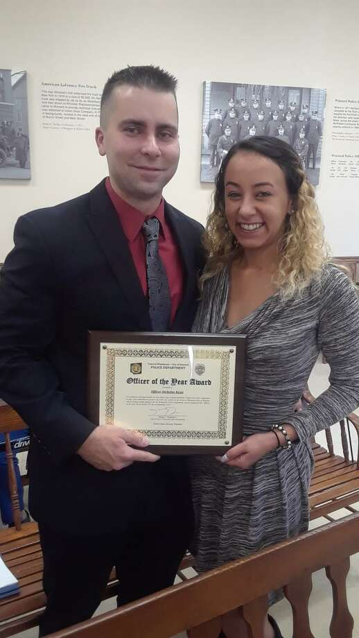 Winchester Police Officer Nicholas Ryan, joined by his girlfriend, Morgan Taylor, was named Officer of the Year at a ceremony Thursday night. Photo: Emily M. Olson / Hearst Connecticut Media /