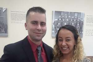 Winchester Police Officer Nicholas Ryan, joined by his girlfriend, Morgan Taylor, was named Officer of the Year at a ceremony Thursday night.