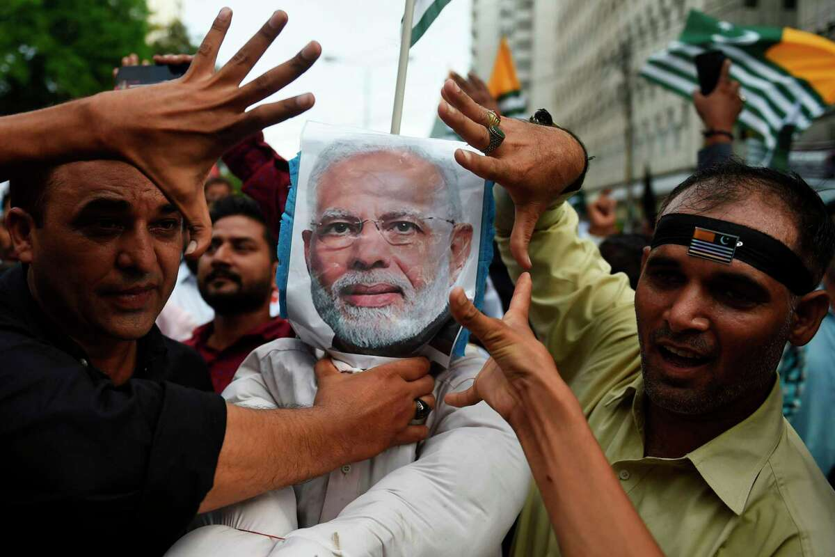 Demonstrators hold an effigy of Indian Prime Minister Narendra Modi during an anti-India protest rally in Karachi on August 25, 2019, in solidarity with India-administered Kashmiri. - The nuclear-armed neighbours regularly target each other with mortar shells and gunfire on the de facto border known as the Line of Control (LoC) in the disputed Himalayan territory which is claimed by both India and Pakistan. (Photo by RIZWAN TABASSUM / AFP)RIZWAN TABASSUM/AFP/Getty Images