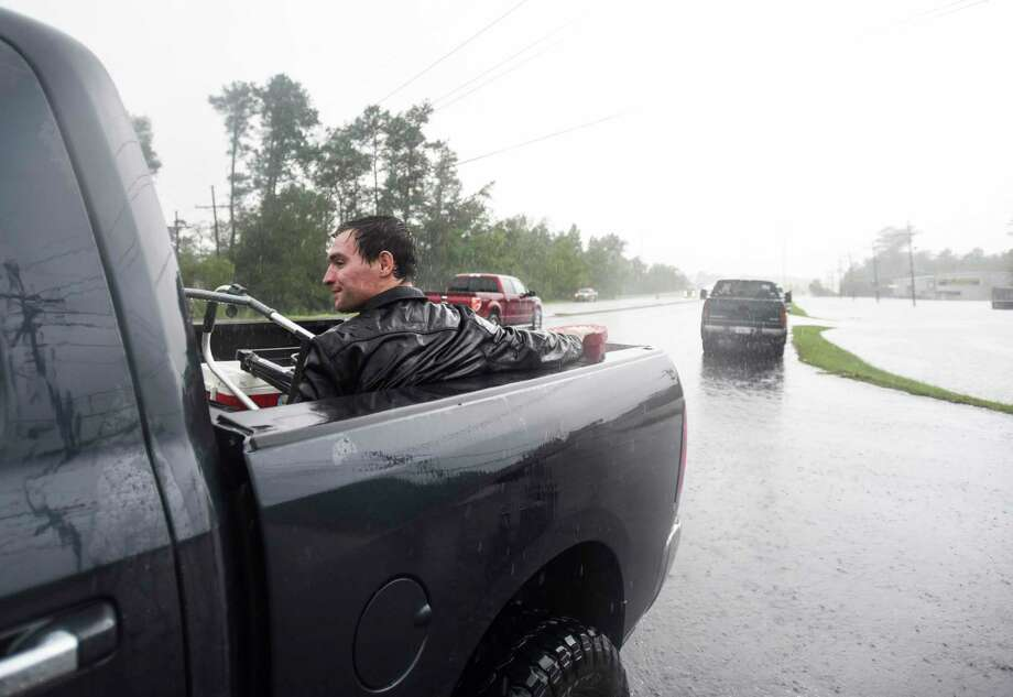 Levi Kelley sits in the back of a truck after getting rescued from his RV once water trapped him in it off of Aery Road in Vidor, Texas Thursday afternoon. Photo taken on Thursday, 09/19/19. Ryan Welch/The Enterprise Photo: Ryan Welch, Beaumont Enterprise / The Enterprise / © 2019 Beaumont Enterprise
