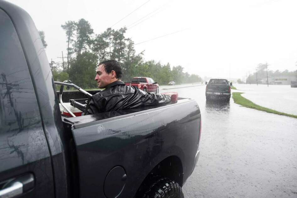 Levi Kelley sits in the back of a truck after getting rescued from his RV once water trapped him in it off of Aery Road in Vidor, Texas Thursday afternoon. Photo taken on Thursday, 09/19/19. Ryan Welch/The Enterprise
