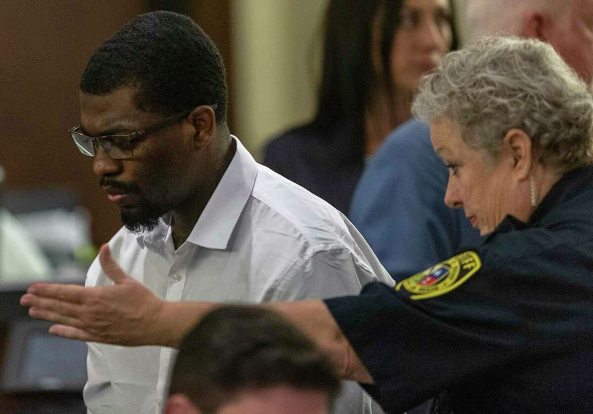 """Montrail """"Tre"""" Thomas Butler, 24, is escorted Thursday, Sept. 19, 2019 to a seat by a bailiff after his murder trial was postponed by 187th state District Court Judge Stephanie Boyd. The trial was finally held this year; Butler was convicted in February of murder in the 2017 shooting of Stephanie Woodford. He is scheduled to be sentenced Wednesday via a Zoom video conference in what could be a first for Bexar County."""