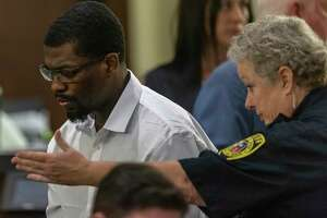 """Montrail """"Tre"""" Thomas Butler, 24, is escorted Thursday, Sept. 19, 2019 to a seat by a bailiff after his murder trial was postponed by 187th state District Court Judge Stephanie Boyd. Butler is charged with the fatal shooting March 18, 2017 of Stephanie Woodford."""