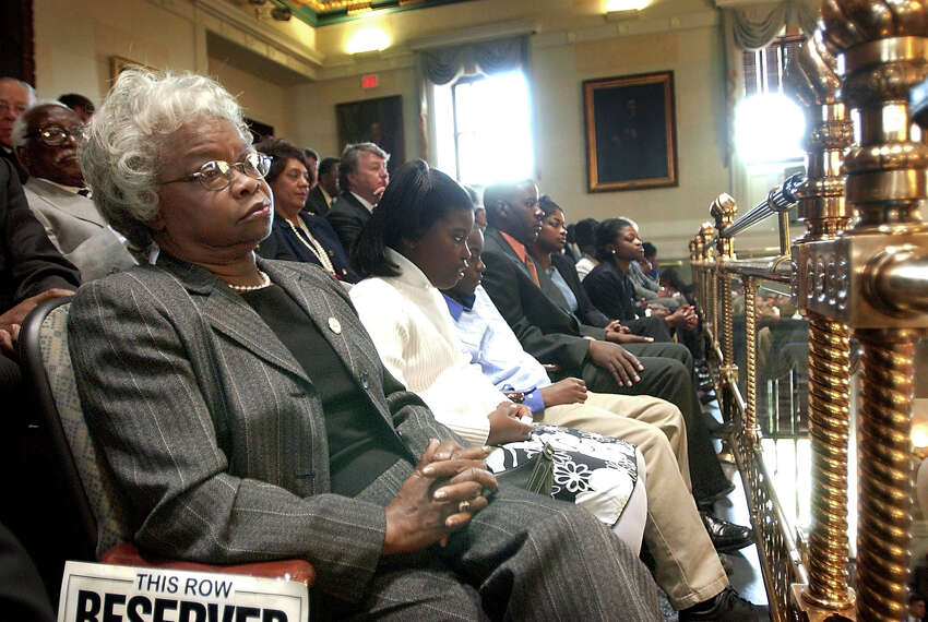 FILE - In this April 10, 2007, file photo, Family members of U.S. House Majority Whip Jim Clyburn, from left, wife Emily Clyburn, grandchildren Sydney and A.C. Reed, son-in-law Walter Reed, daughters Jennifer and daughter Angela, listen as he addresses a joint session of the South Carolina Legislature in Columbia, S.C. Emily Clyburn, the wife of House Majority Whip Jim Clyburn of South Carolina who helped raise millions of dollars to help students attend the alma mater they shared, died in Columbia on Thursday morning, Sept. 19, 2019. according to the congressmana€™s office. She was 80. (Tim Dominick/The State via AP, File)