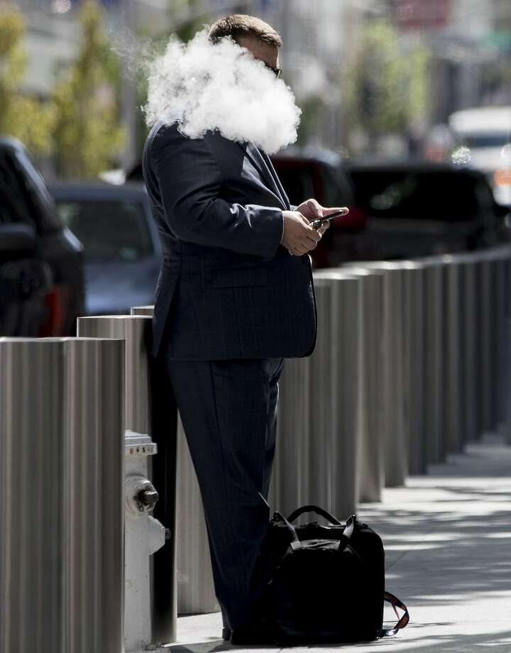 A man smokes an e-cigarette outside of the Transbay Transit Center in San Francisco, Calif. Thursday, September 19, 2019. Photo: Jessica Christian / The Chronicle