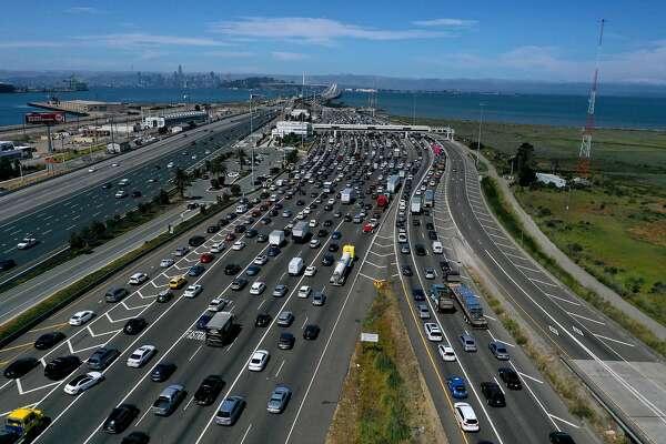SAN RAFAEL, CALIFORNIA - JULY 25: Traffic backs up at the San Francisco-Oakland Bay Bridge toll plaza along Interstate 80 on July 25, 2019 in Oakland, California. The State of California and four of the largest automakers in the world - Ford, VW, Honda an